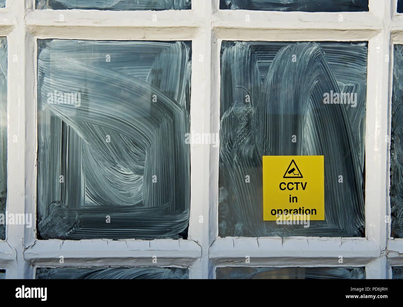 Sign - CCTV in operation - on shop window, England UK - Stock Image