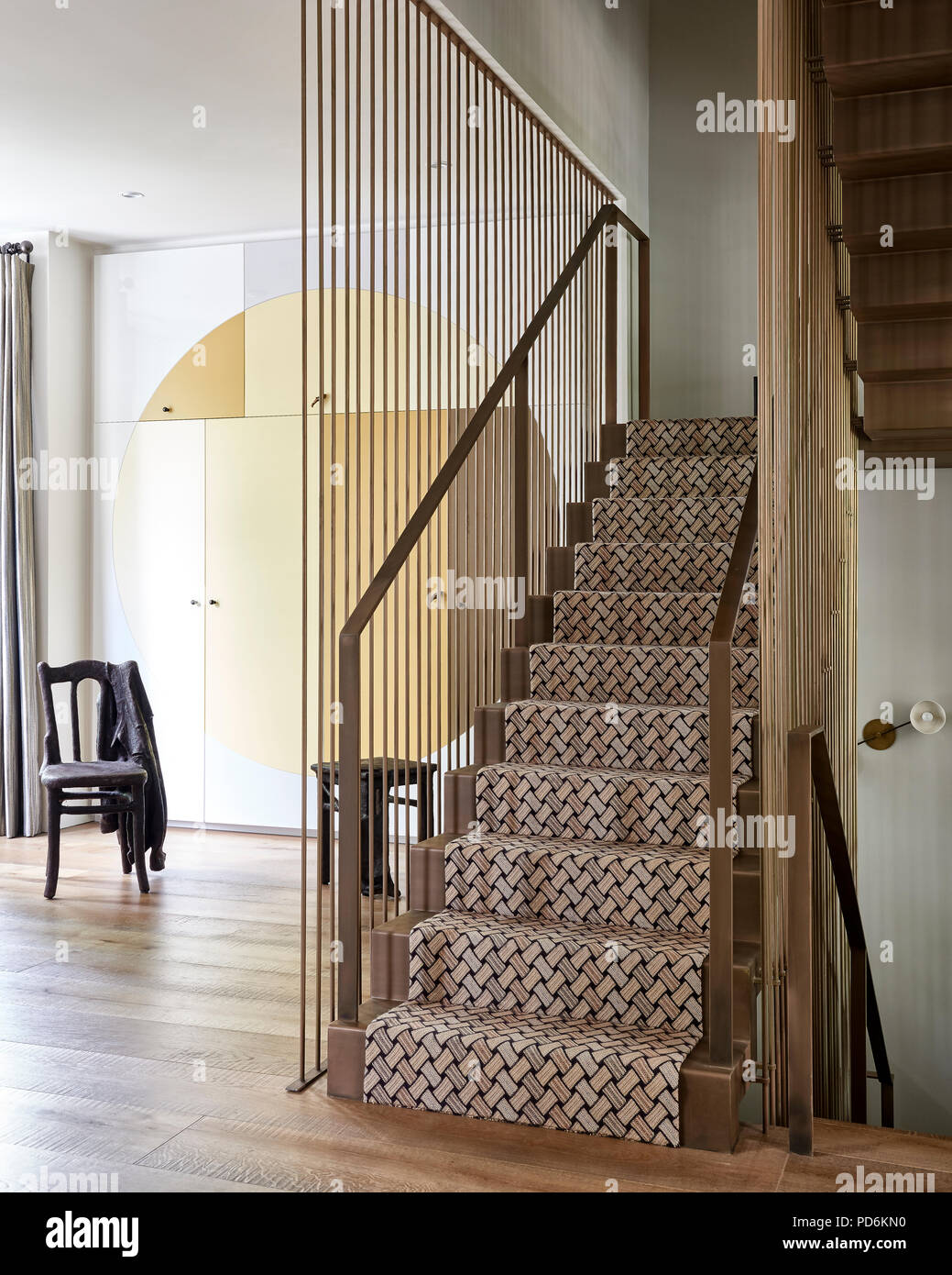 Latticed carpet with metallic handrail and banisters and concealed storage - Stock Image