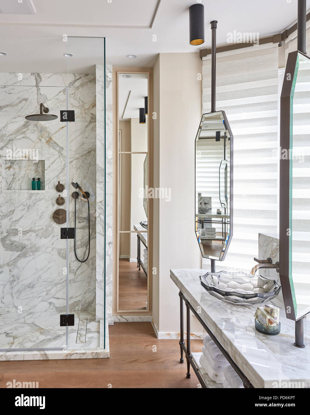 Marble shower cubicle with vintage mirrors and glass washbasin. - Stock Image