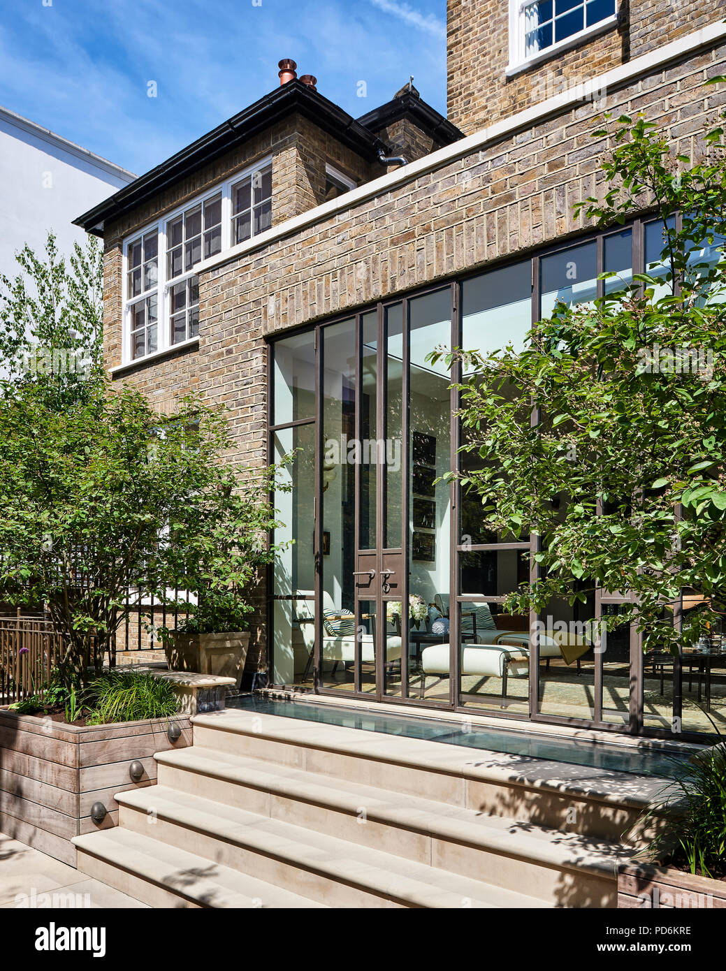 Bouble height backyard exterior of Victorian London home - Stock Image
