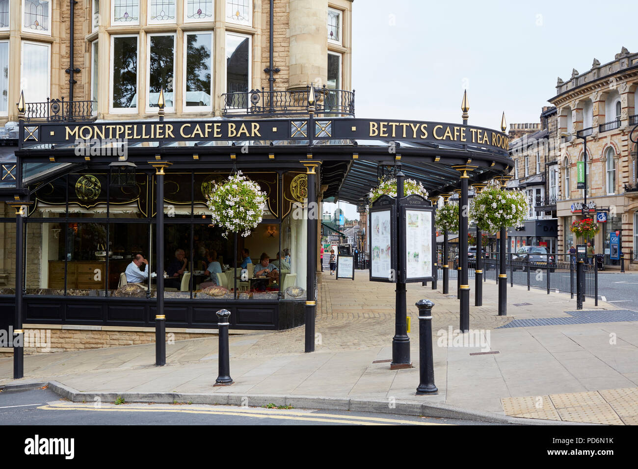 Exterior of Betty's Cafe with Victorian cast iron canopy, Harrogate, North Yorkshire - Stock Image