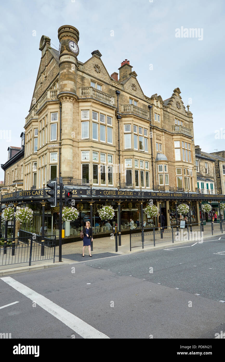Exterior of the famous Betty's Cafe with Victorian cast iron canopy, from across Parliament Street, Harrogate, North Yorkshire - Stock Image