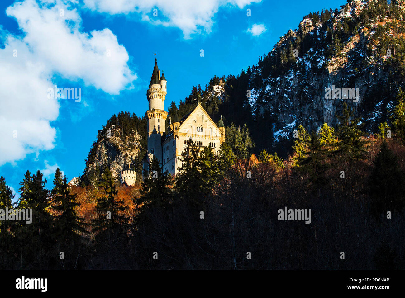 German disney castle in the mountains on a sunny day with blue sky - Stock Image