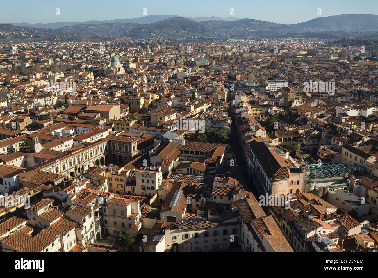 Great Synagogue of Florence also known as the Tempio Maggiore rising over the tiled roofs of the Florence downtown pictured from the dome of the Florence Cathedral (Duomo di Firenze) in Florence, Tuscany, Italy. Stock Photo