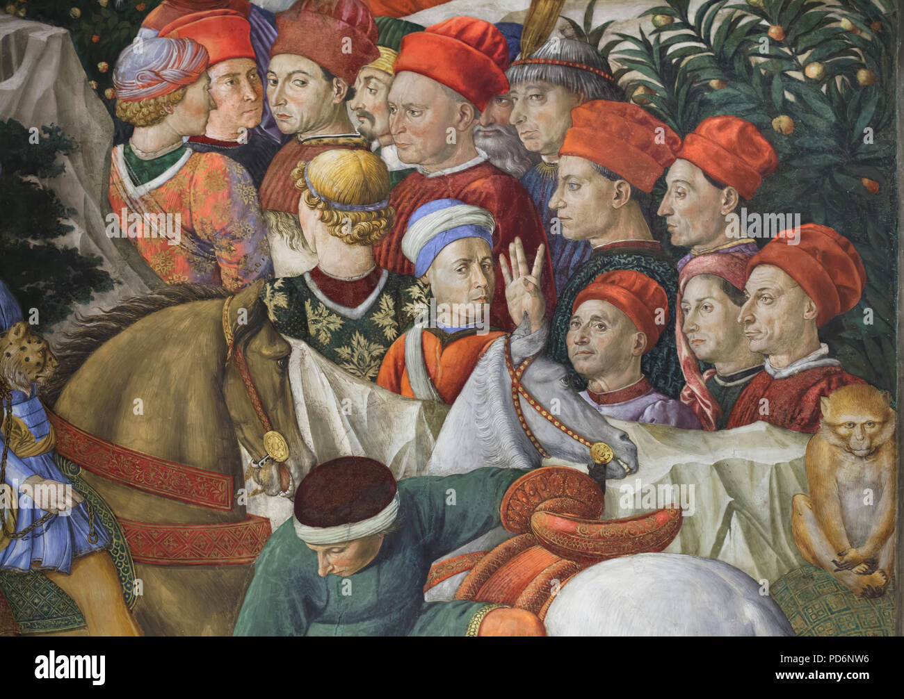 Self-portrait of Italian Renaissance painter Benozzo Gozzoli (in the white and blue hat in the centre) depicted in the mural by Benozzo Gozzoli in the Magi Chapel in the Palazzo Medici Riccardi in Florence, Tuscany, Italy. Stock Photo