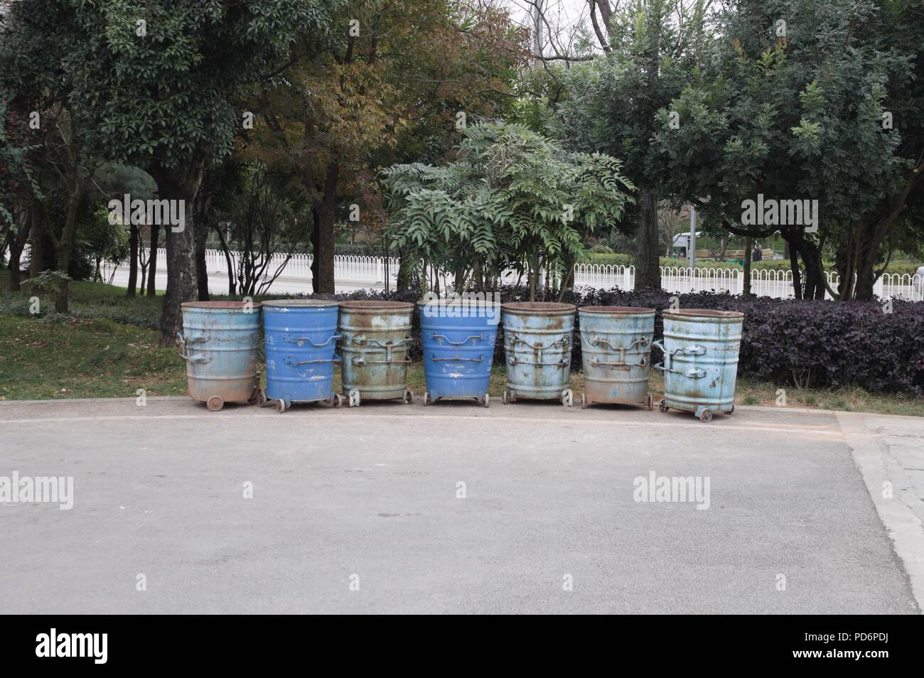 Trash cans lined up (Kunming, Yunnan, China) - Stock Image