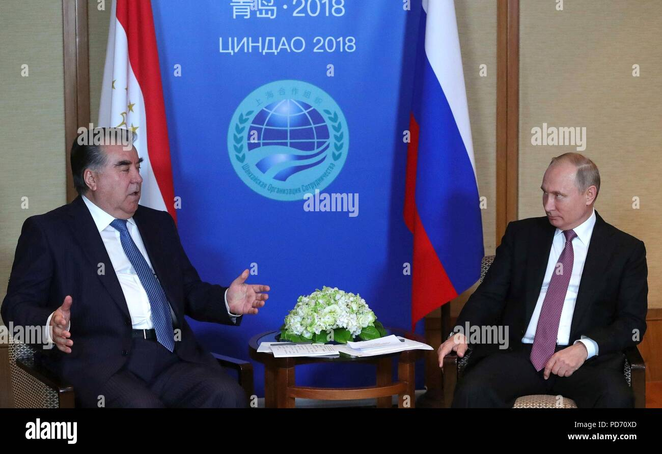 Russian President Vladimir Putin, right, holds a bilateral meeting with Tajik President Emomali Rahmon on the sidelines of the Shanghai Cooperation Organisation Summit June 9, 2018 in Qingdao, China. - Stock Image