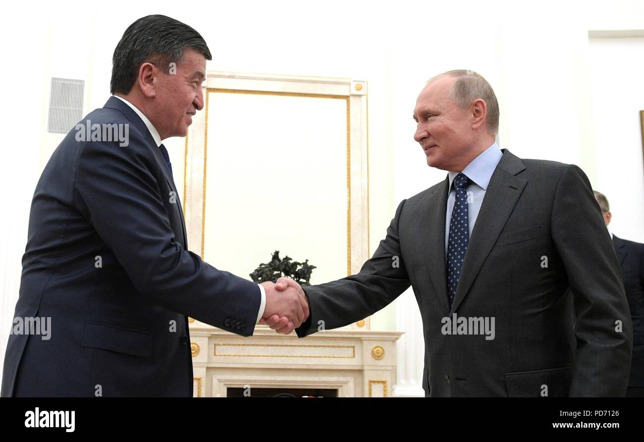 Russian President Vladimir Putin shakes hands with Kyrgyz President Sooronbay Jeenbekov prior to a bilateral meeting at the Kremlin June 14, 2018 in Moscow, Russia. - Stock Image