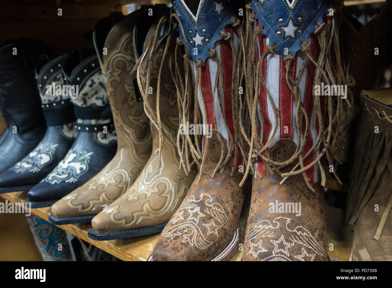 e5b95958e0b Rows of cowboy boots for sale in a boot shop in Nashville, TN, USA ...