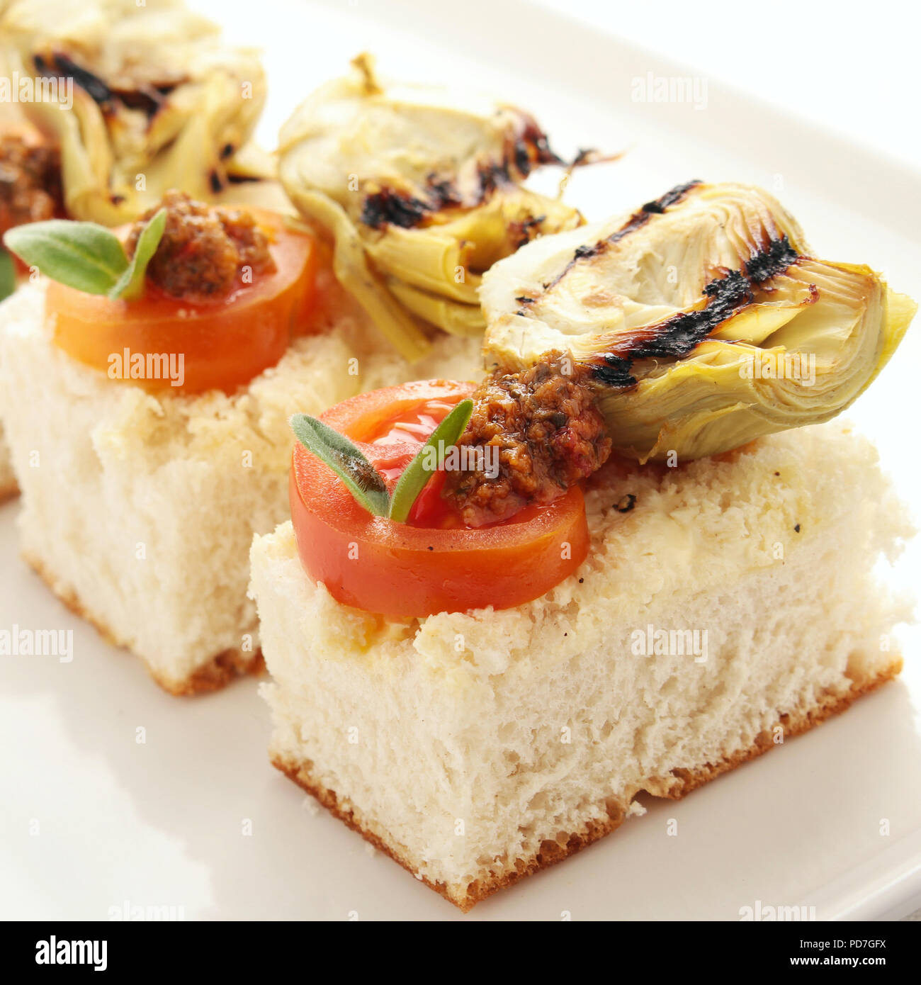 making bruschetta canapes - Stock Image