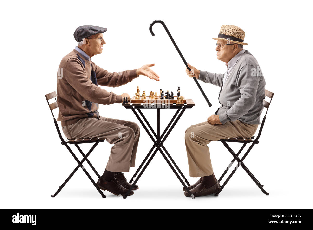 Seniors playing a game of chess and arguing isolated on white background - Stock Image