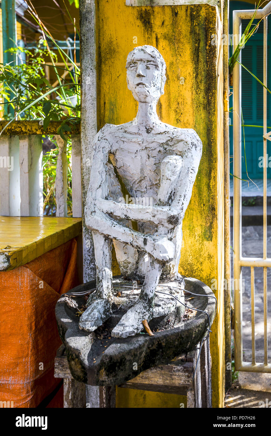 Editorial: aug 16, 2017, Hoi An Ancient town, Vietnam, art gallery. Front of an art store is a statue that is carved out of plaster or cement. Looks l - Stock Image