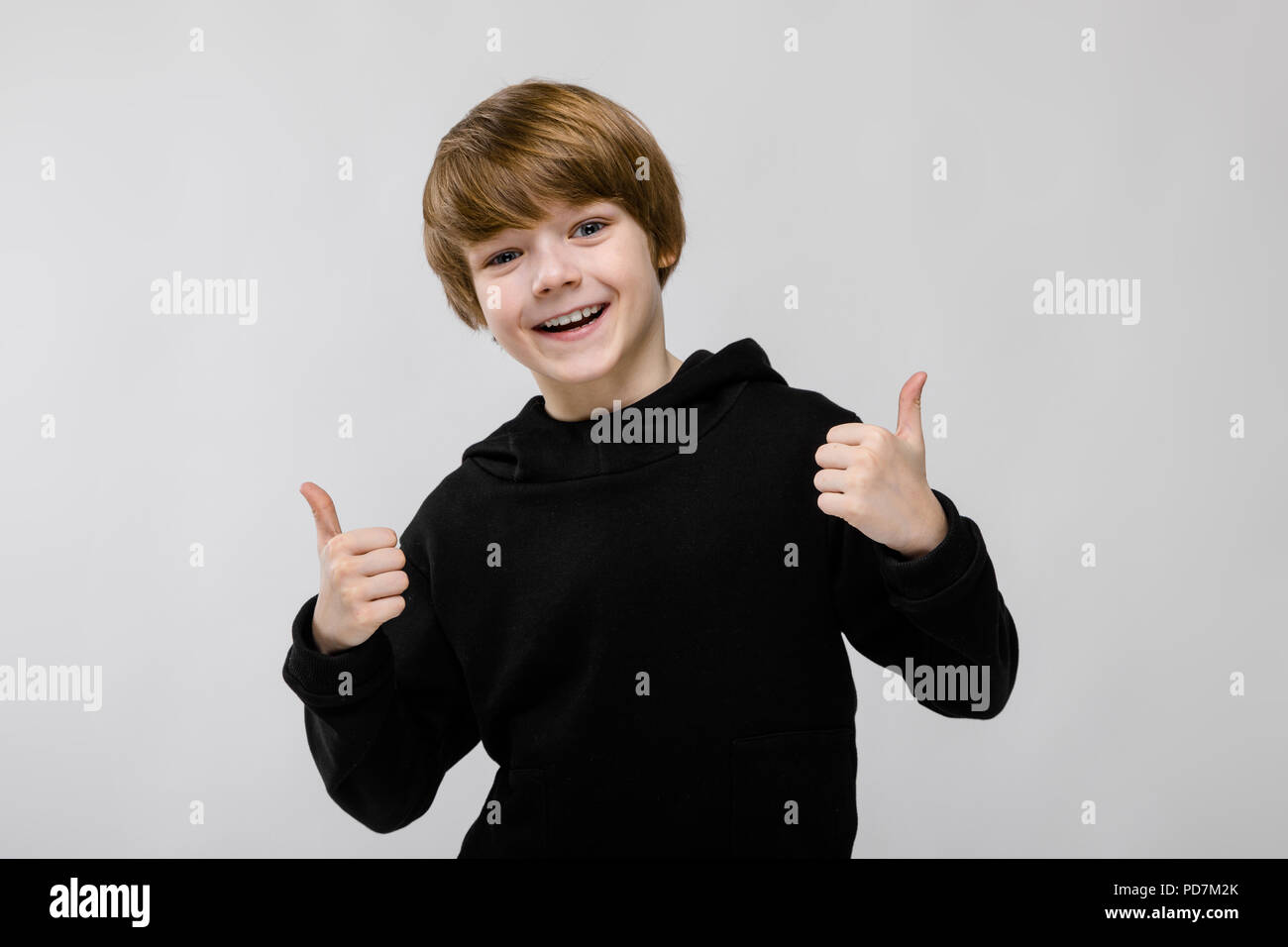 Teenage boy in fashionable clothes - Stock Image