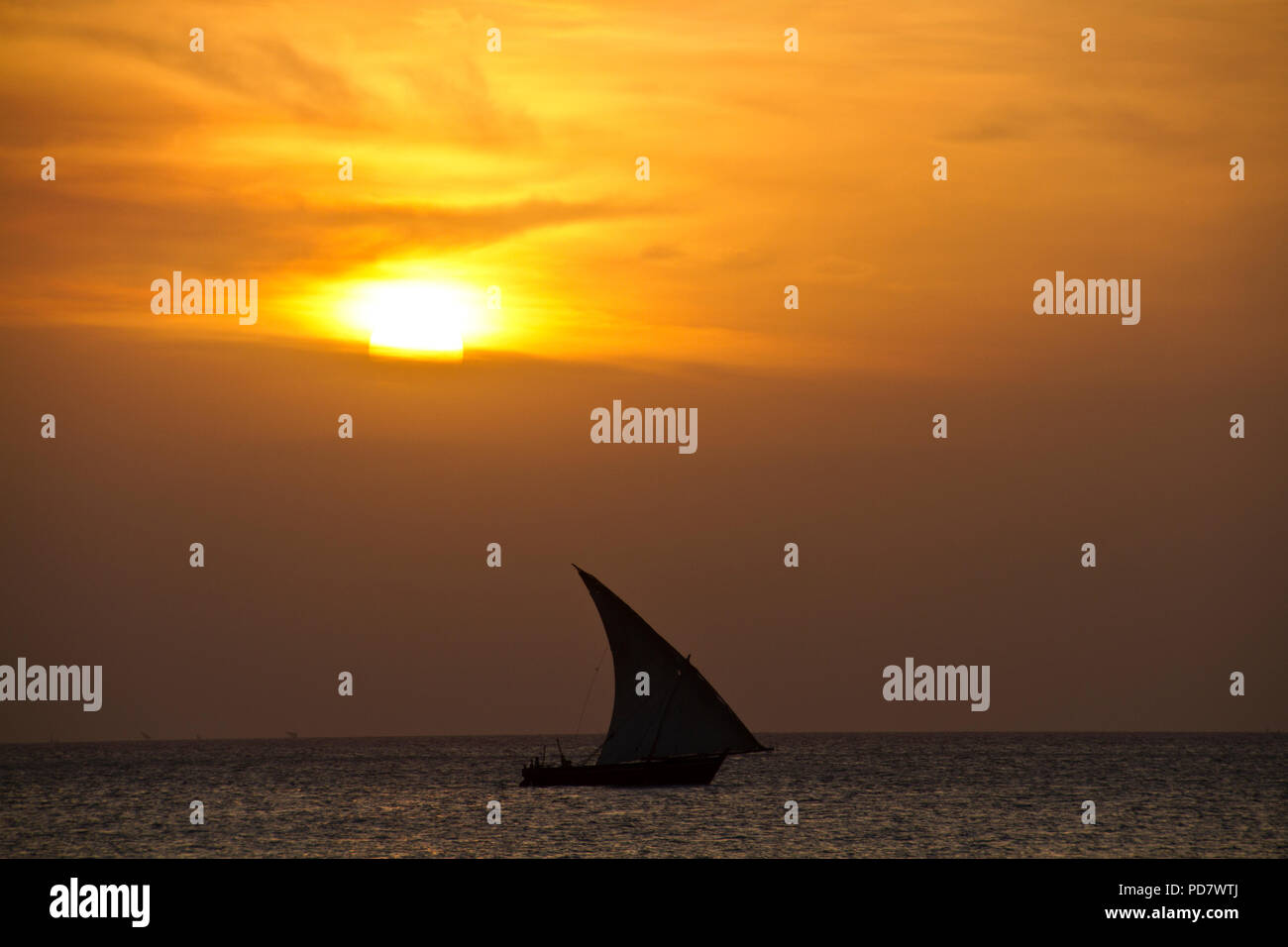 A Johazi, a smaller version of the Dhow is a traditional Arab sailing vessel and still widely used for local commerce and fishing on Zanzibar - Stock Image