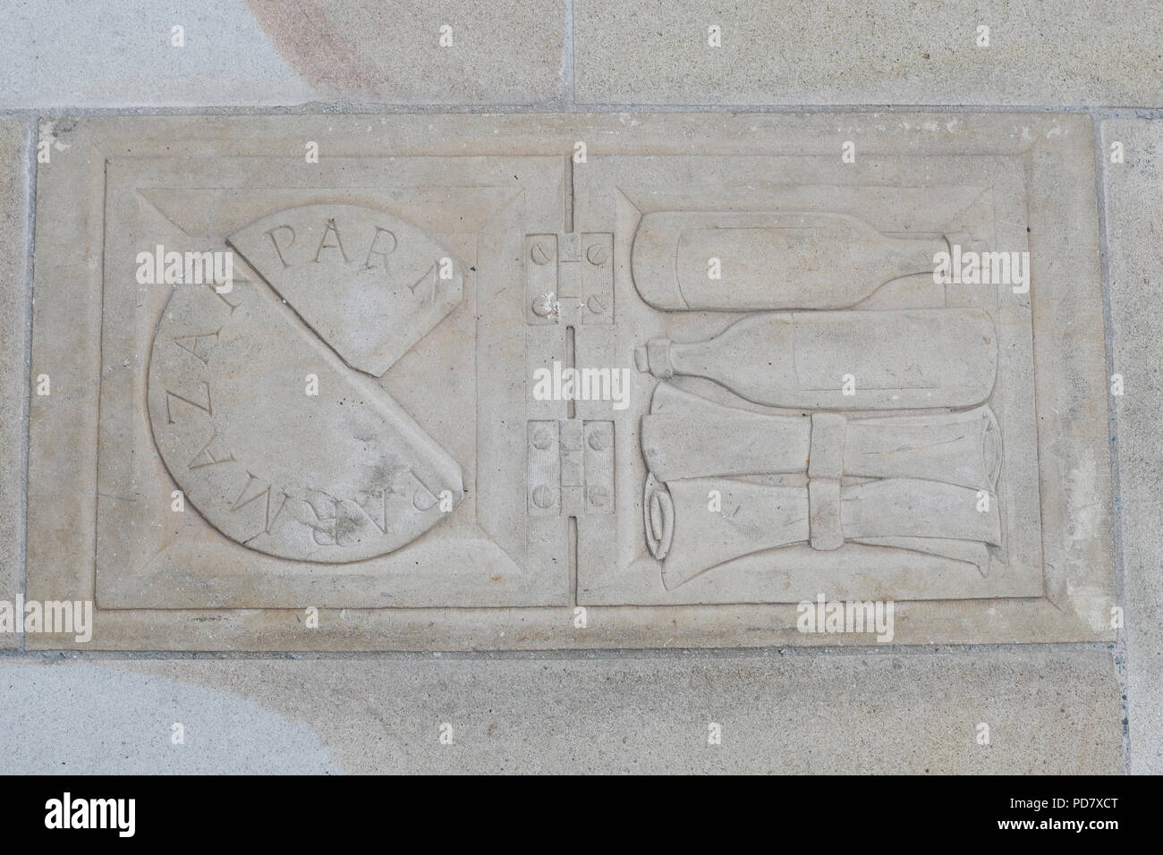 A stone relief set into the pavement to commemorate Samuel Pepys hiding his parmesan cheese during the Great Fire of London - Stock Image