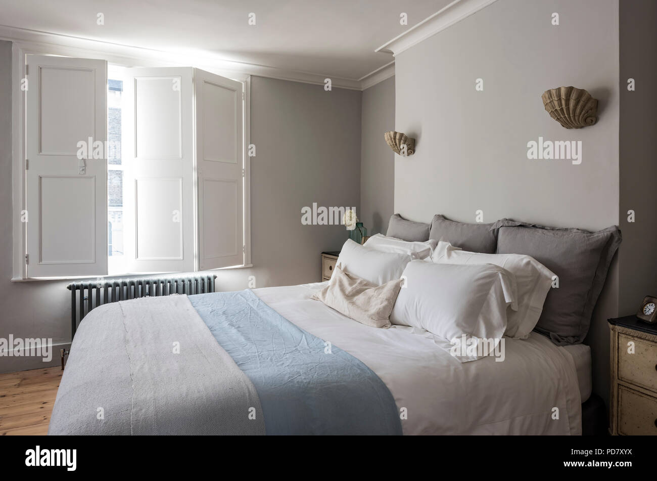 Elegant Bedroom With Window Shutters And Scallop Wall Sconce Lights From  Cox London Lighting.