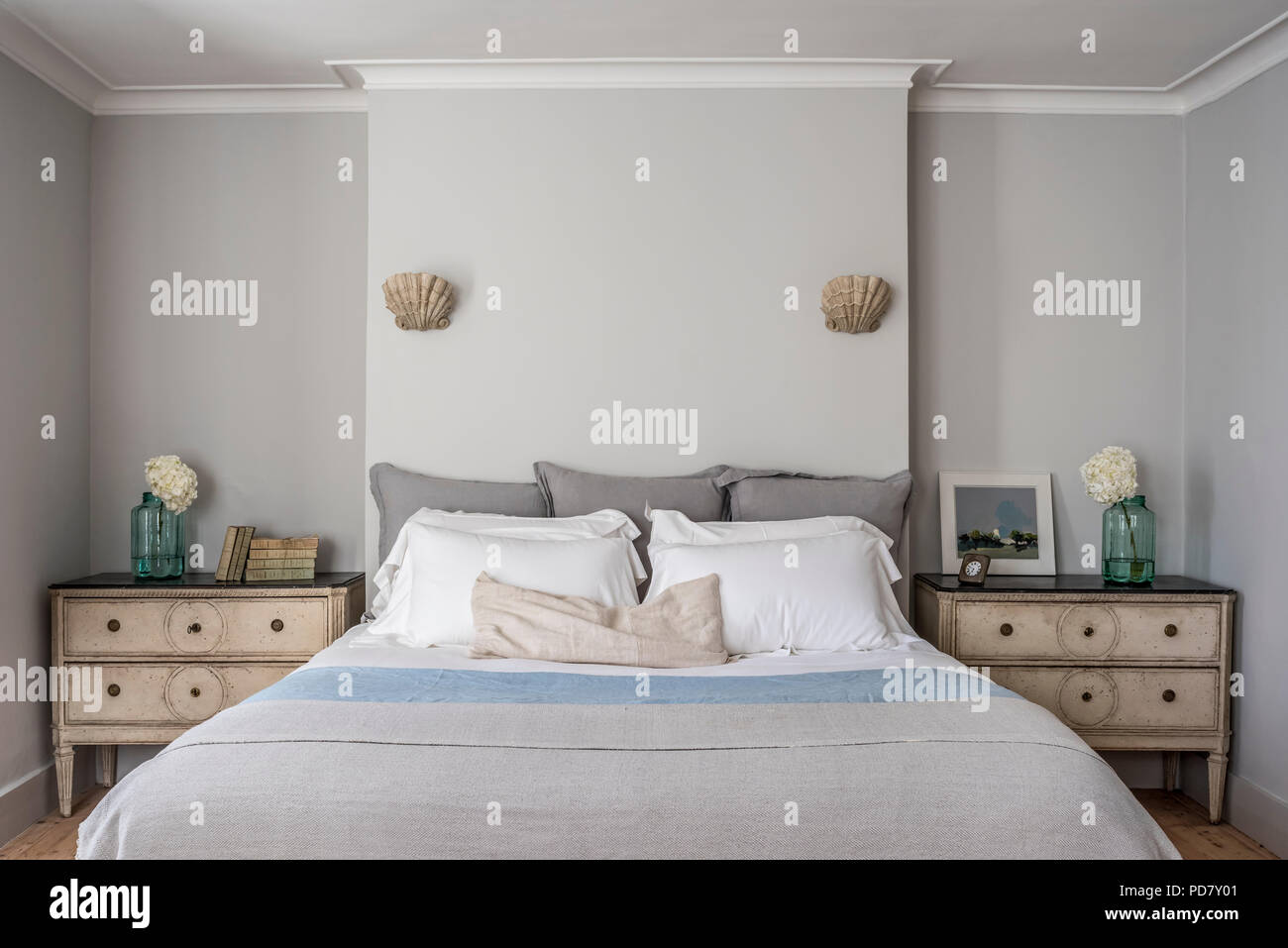 Elegant Bedroom With Window Shutters And Scallop Wall Sconce Lights From  Cox London Lighting. The Bed Is Flanked By A Pair Of Gustavian Painted  Swedis