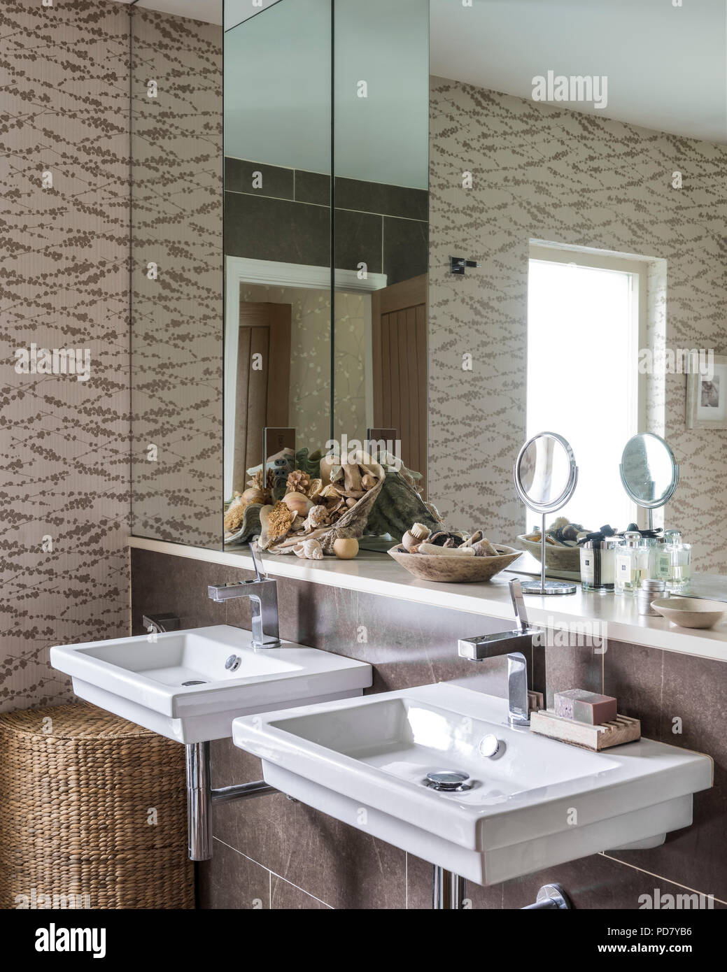 Sticks wallpaper from Knowles and Christou in bathroom with pair of duravit basins and taps by Citterio from Hans Grohe - Stock Image