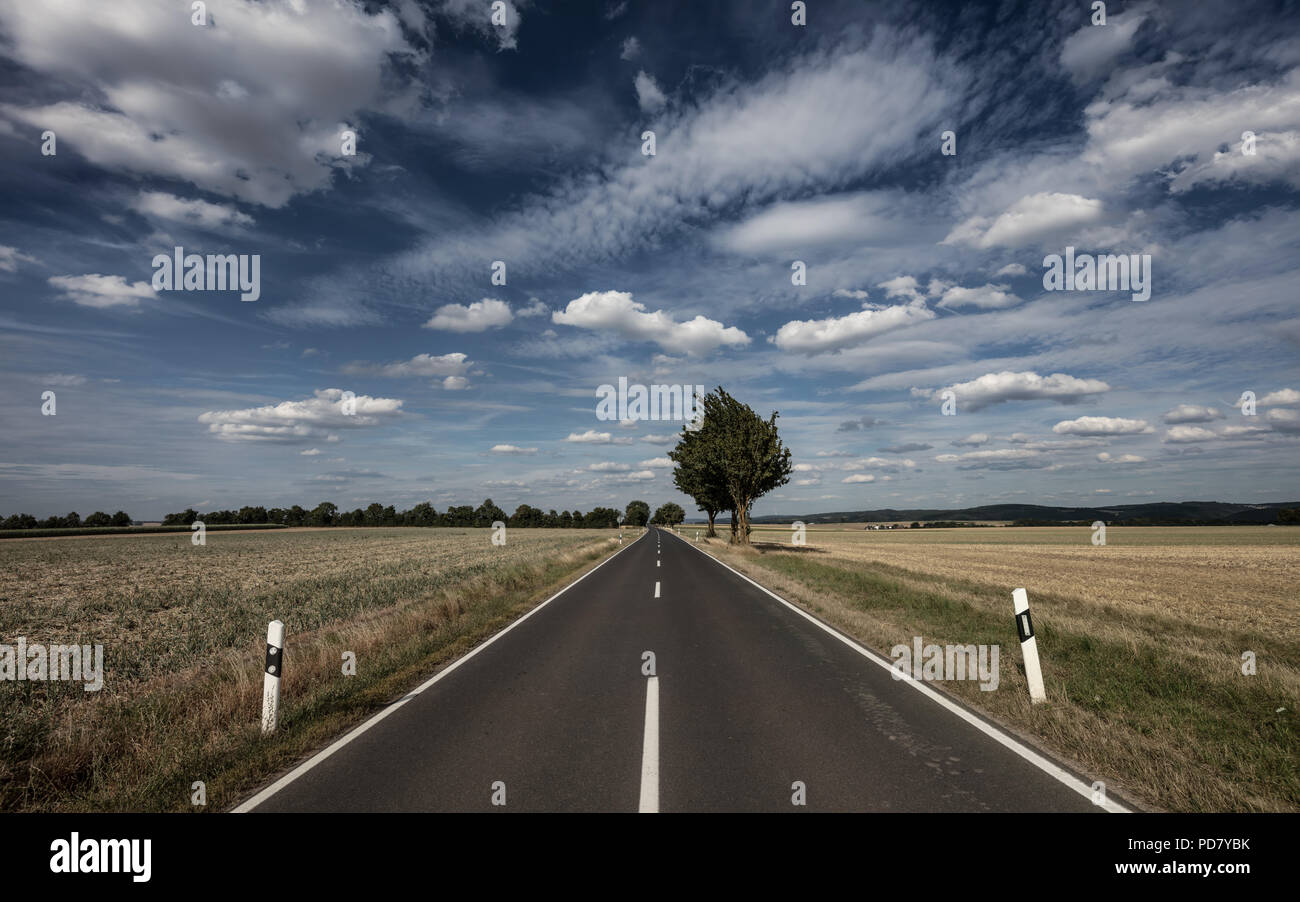 Endless country road in Germany - Stock Image
