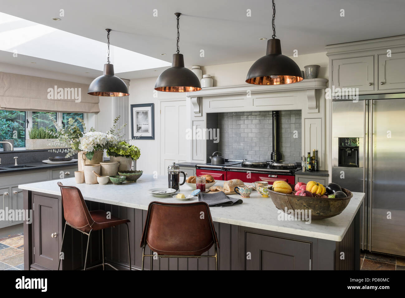 Bespoke kitchen island by Thomas Ford & Sons is painted in ...