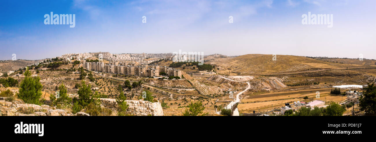 Panoramic view from Shepherds field, near Bethlehem, in the West Bank Palestinian area with Arab housing in the mid ground, followed by the Separation - Stock Image