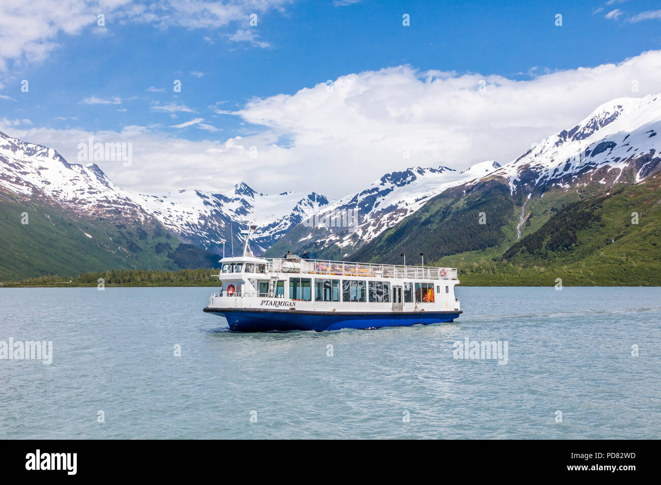 Glacier tour boat mv Ptarmigan on Portage Lake which  is a glacial lake in the Chugach National Forest on the Kenai Peninsula of Alaska - Stock Image