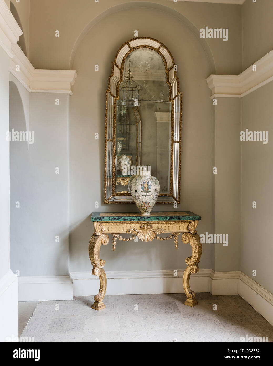 Antique French Gilt Wood and Marble Console Table under gilt framed mirror Stock Photo