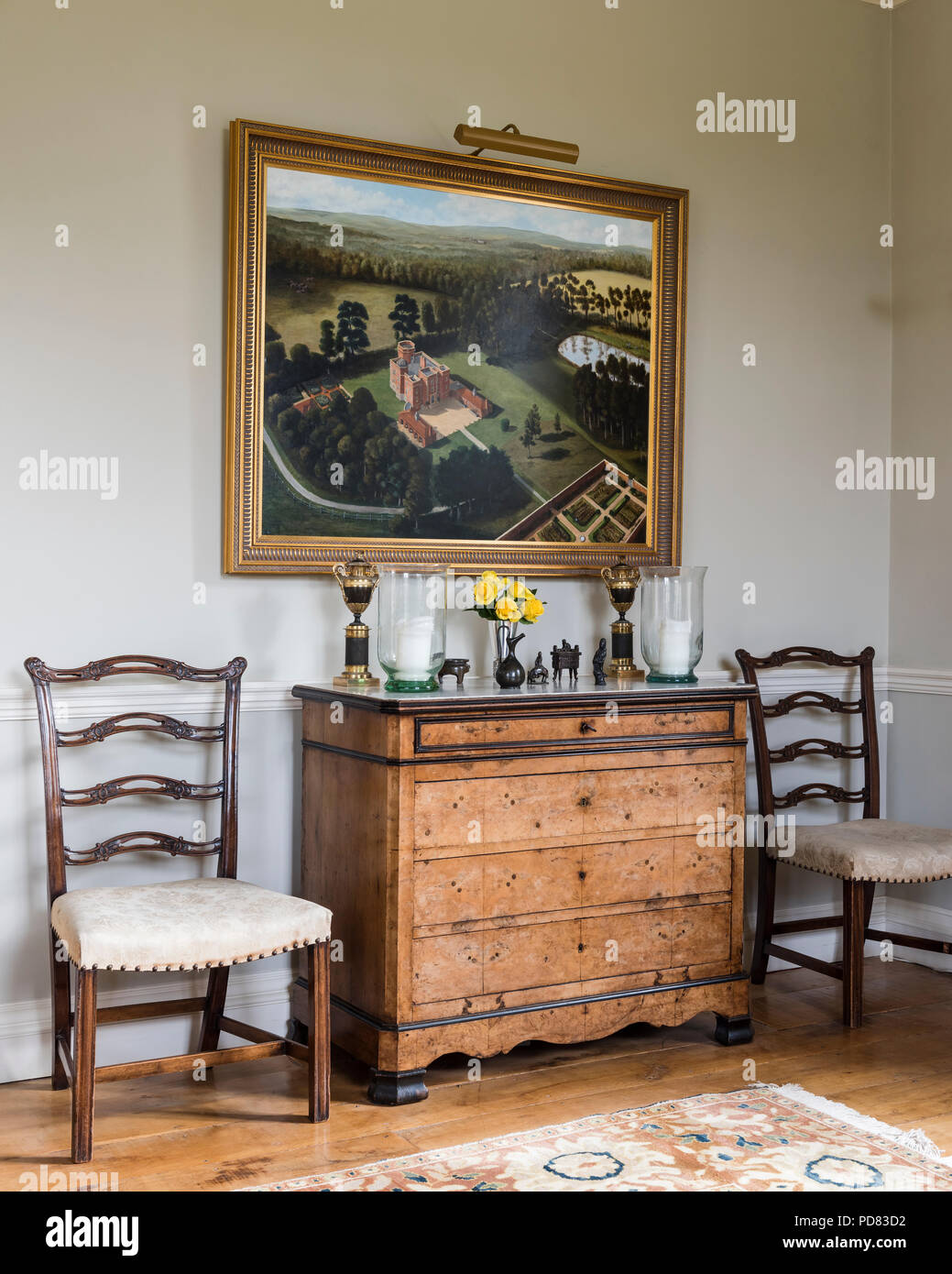 Gilt framed oil painting of Whithurst Park above a chest of marble topped drawers Stock Photo