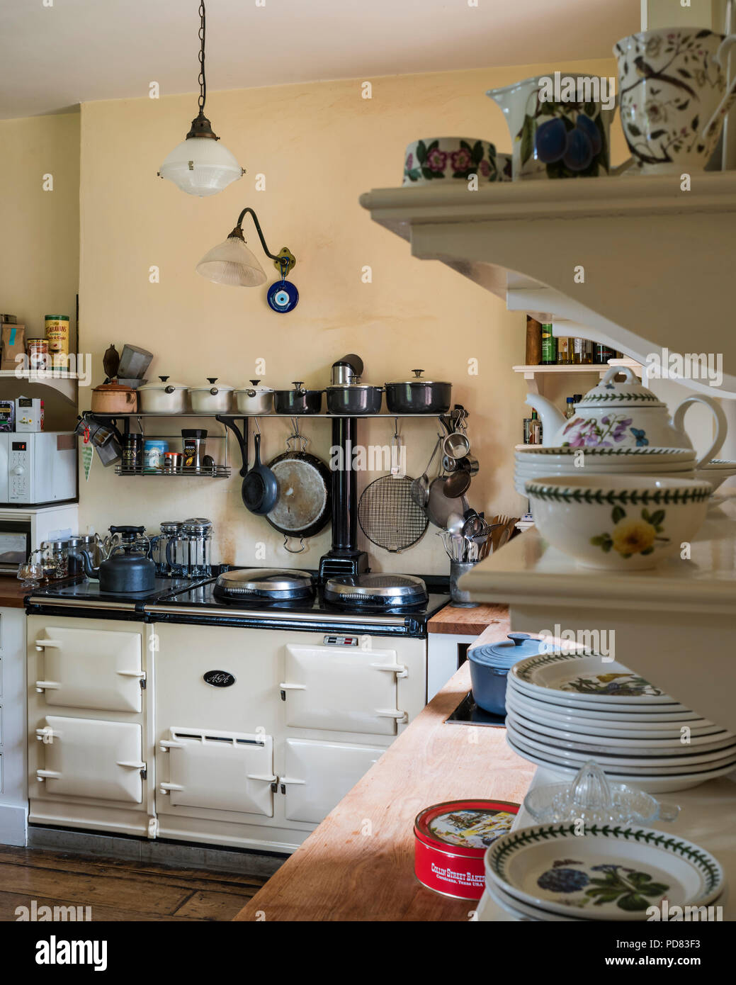 Cream Aga in country style kitchen with cabinets by Kitt Rae-Scott Stock Photo