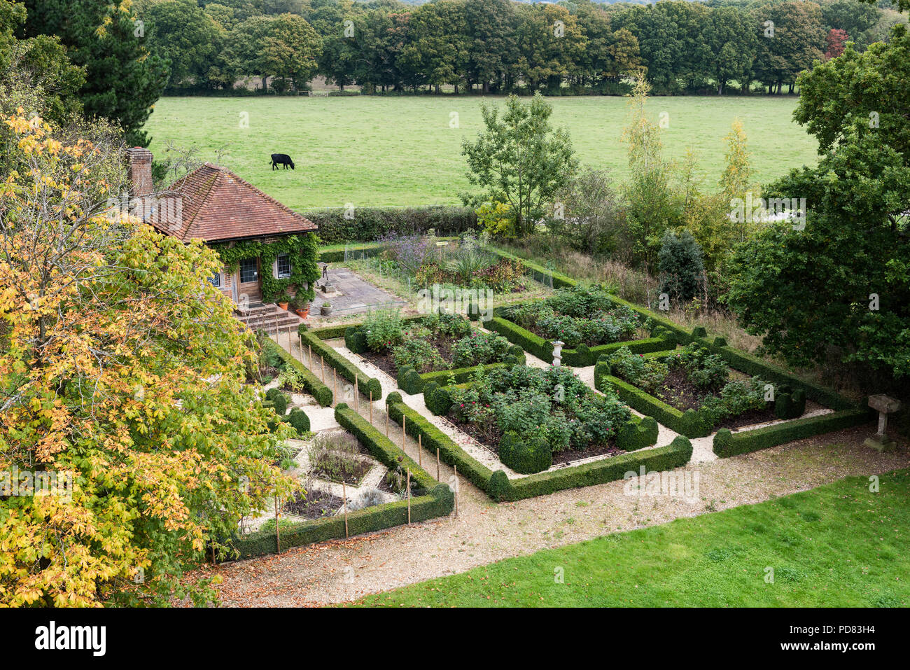 Small potting shed within the parterre garden and box hedge Stock Photo