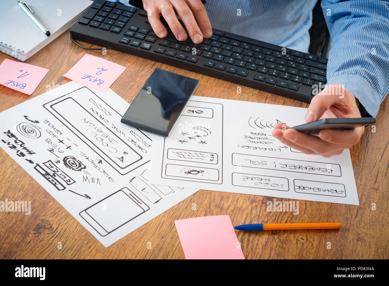 Designer working at new mobile applications - Stock Image