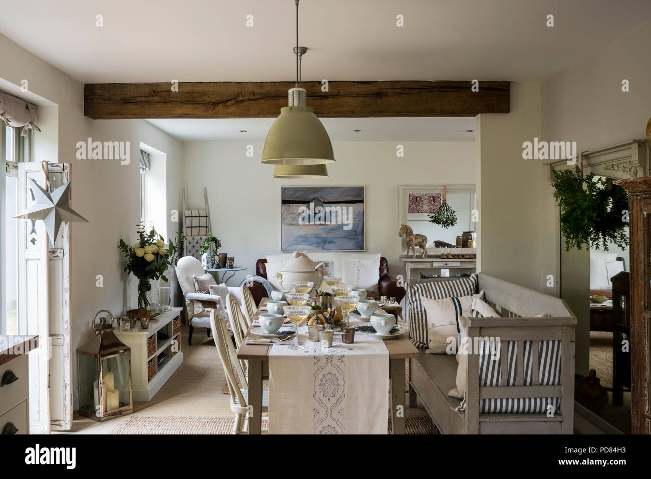 Dining table in rustic cottage kitchen with beamed ceiling ...