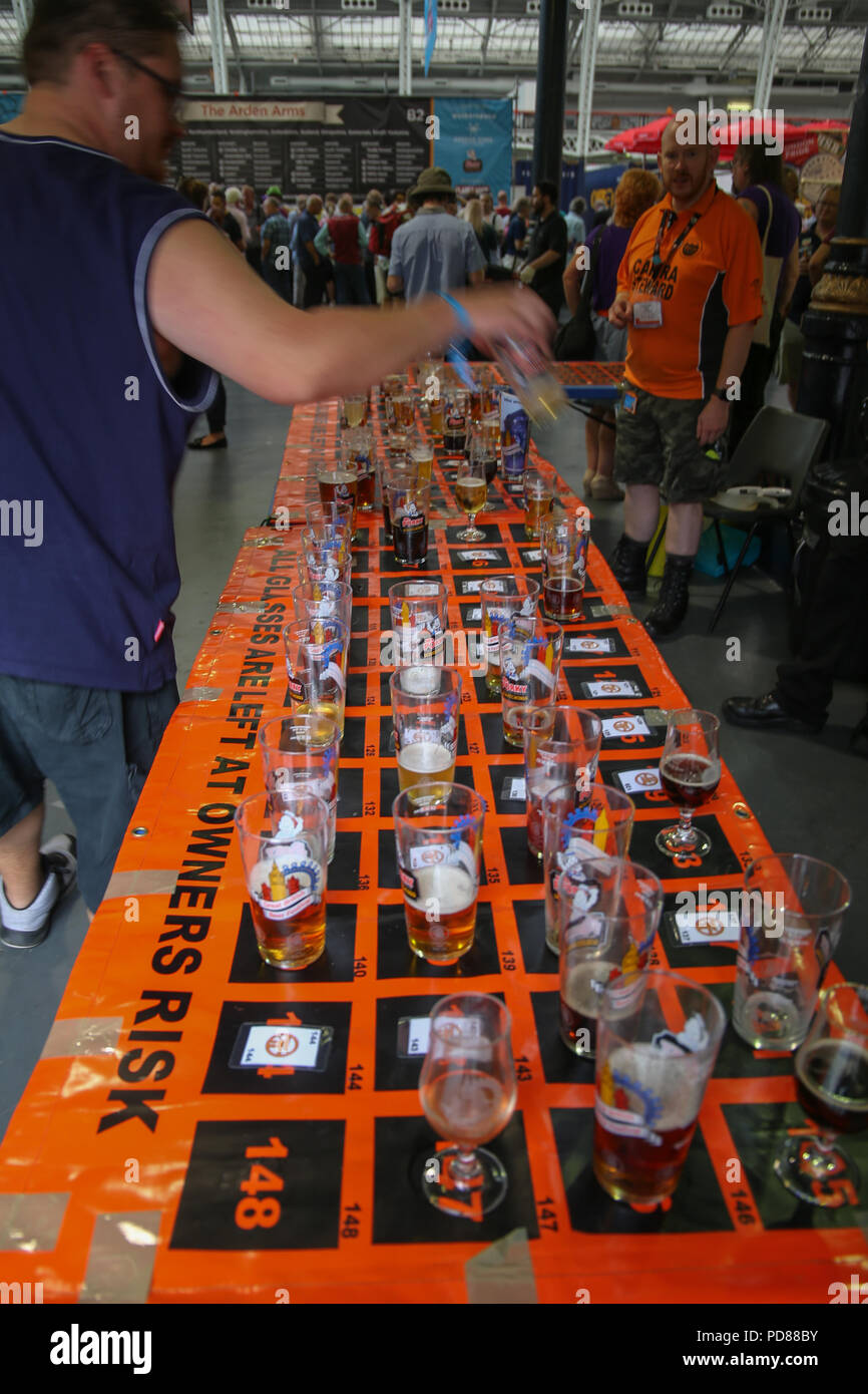 London UK 07 August 2018  If you need a loo or ciggy break at the Great British Beer Festival  2018 ,put your glass in the table retrieve the number and come back once all is done to find your beer waiting @Paul Quezada-Neiman/Alamy Live News - Stock Image