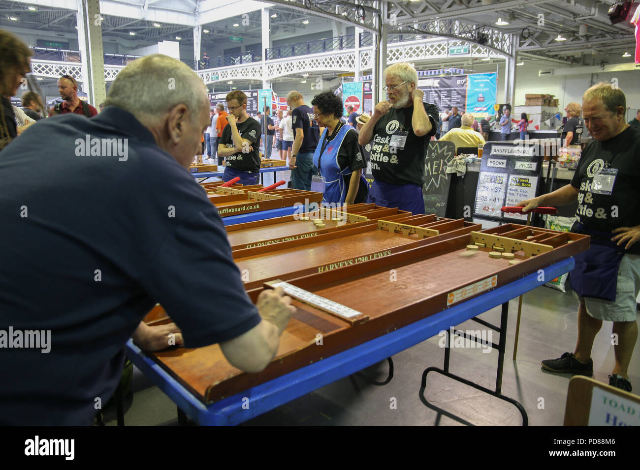 London UK 07 August 2018  for some one glass wasnt enough at the Great British Beer Festival held from today until the 11th of August at the London Olympia,traditional PUB games ,thousands of beers ciders ,stouts wines real ales,pale ales  and pub grup  to keep everybody happy @Paul Quezada-Neiman/Alamy Live News - Stock Image