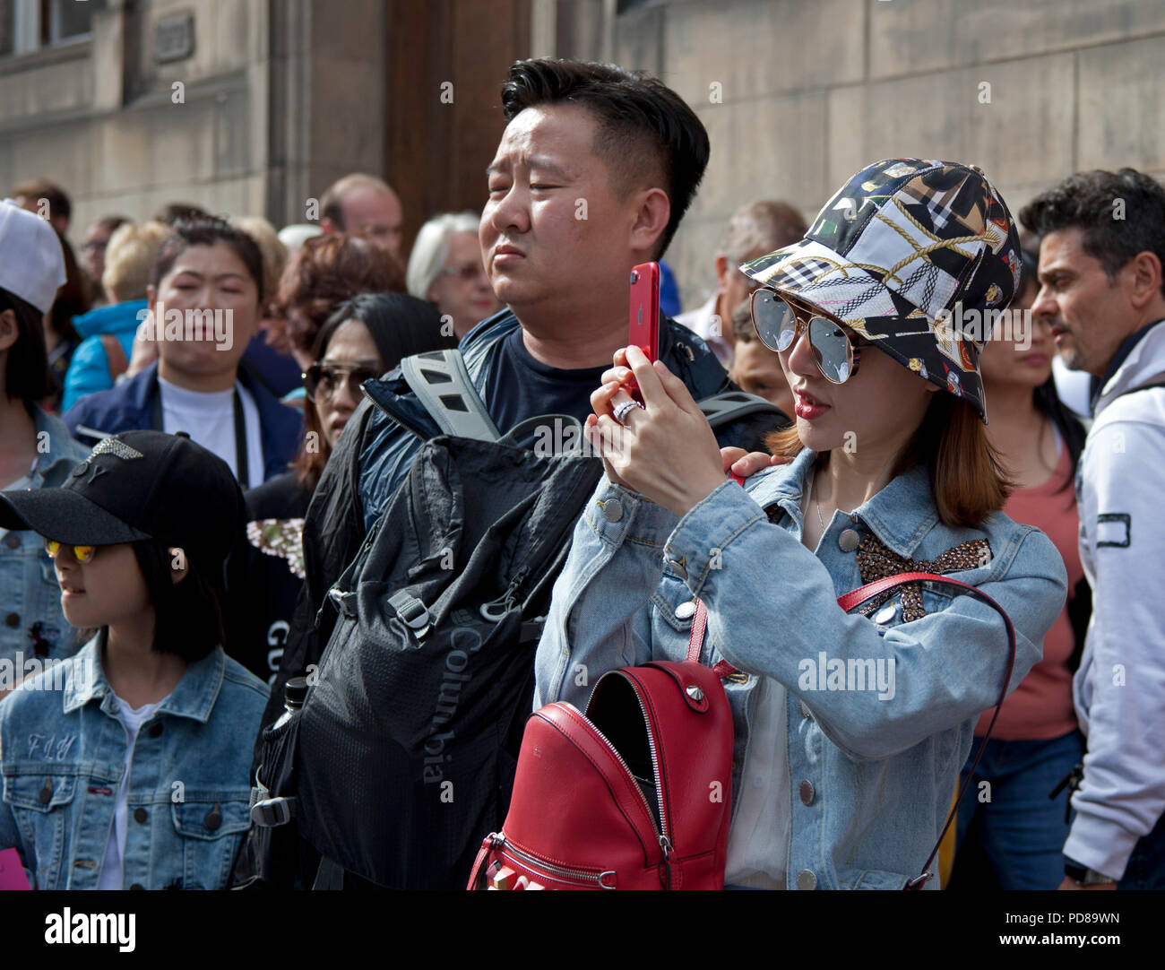 Edinburgh, Scotland UK, 7 August 2018, Edinburgh Fringe on the Royal Mile, on a sunny afternoon the sublime to the ridiculous took to the street with a flashing street statue and a street performers novel way to make use of plumbing plungers and some interesting looking audience members. - Stock Image