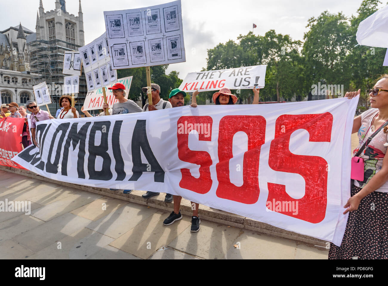 London, UK. 7th August 2018. Colombians and supporters of human right hold banners, Colombian flags and pictures of over a hundred murdered community leaders at a  protest in Parliament Square in support of the peace process in Colombia and demanding an end to the daily threats and murders throughout the country. ook place today at the Credit: Peter Marshall/Alamy Live NewsStock Photo