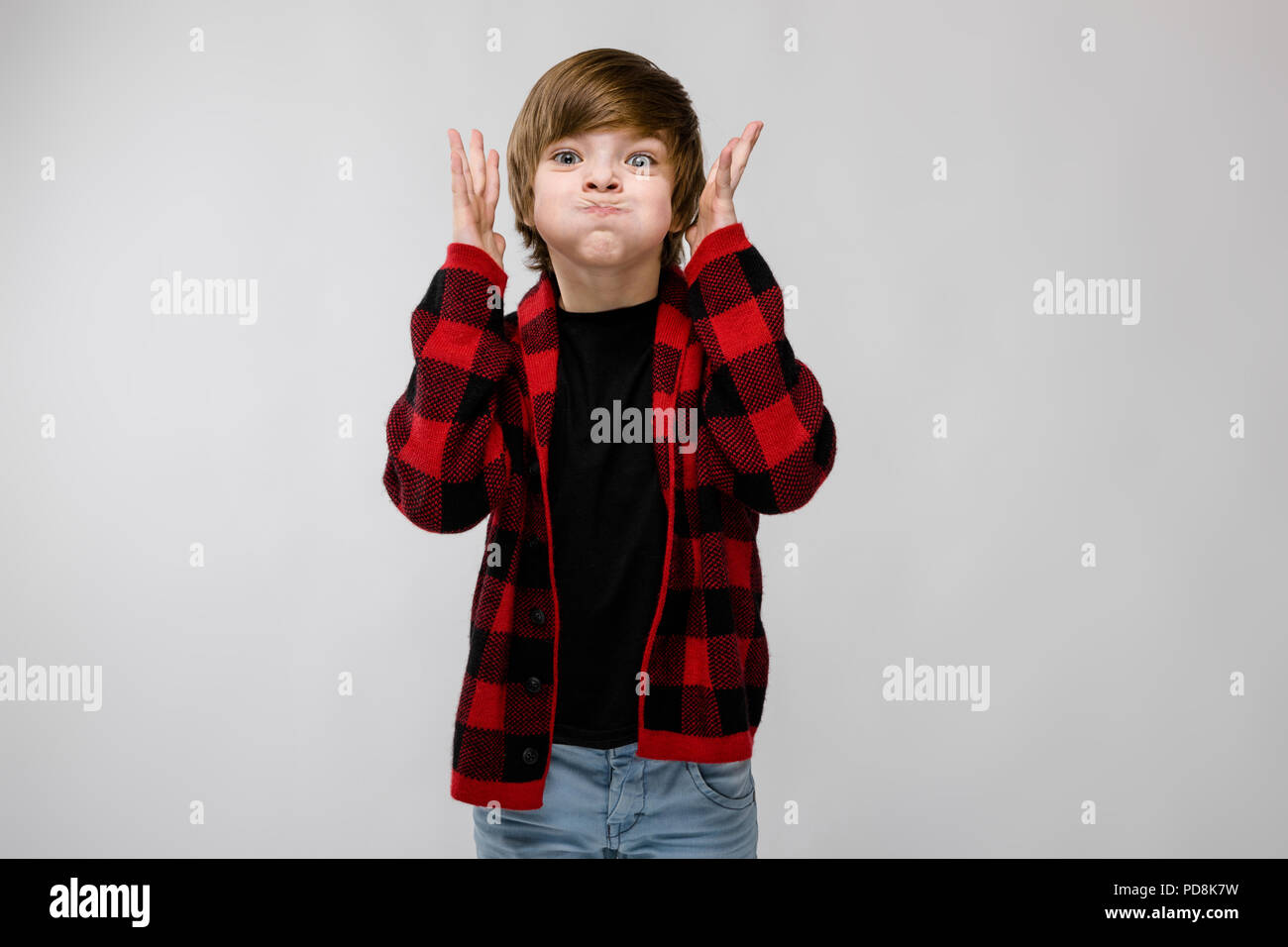 Happy teenage boy in fashionable clothes - Stock Image