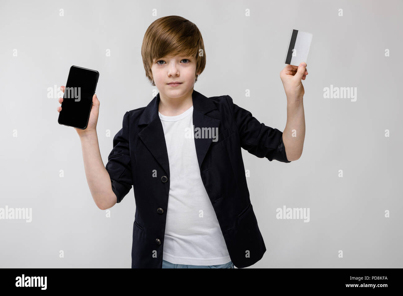 Cute boy with telephone and card - Stock Image