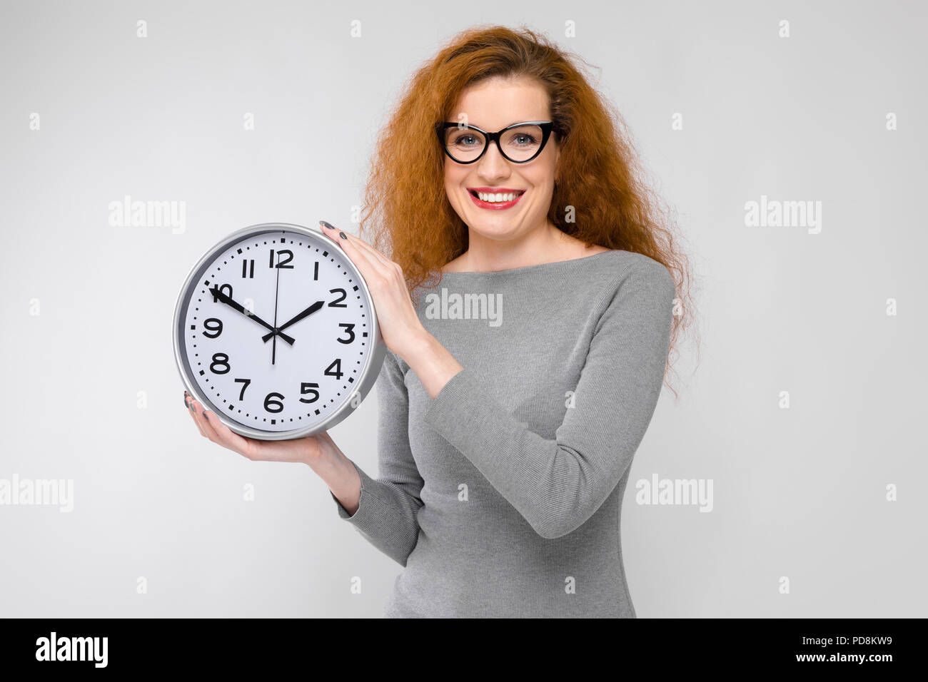 Young woman with clocks - Stock Image