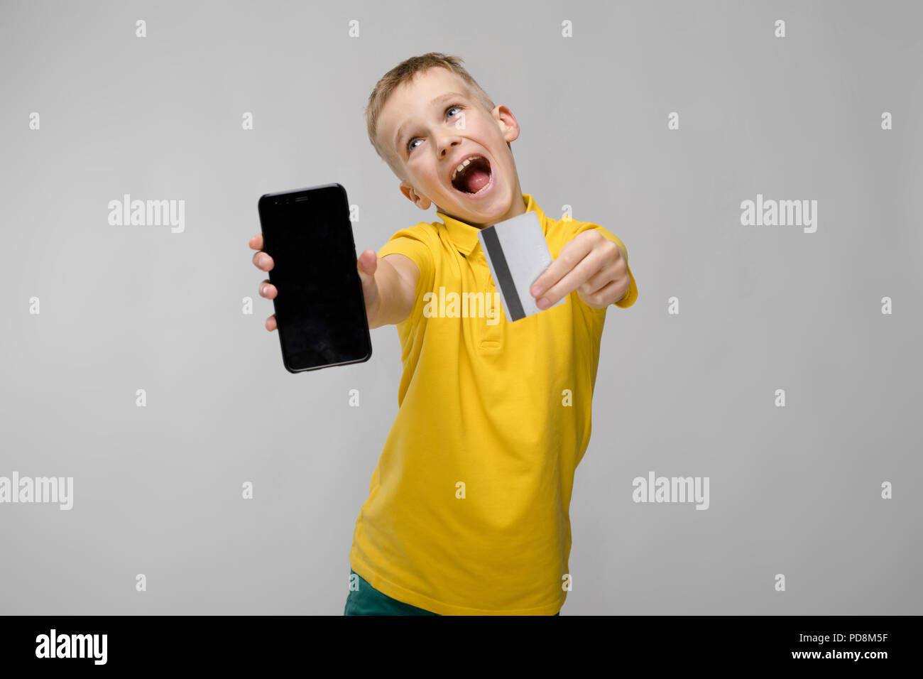 Cute boy with telephone - Stock Image