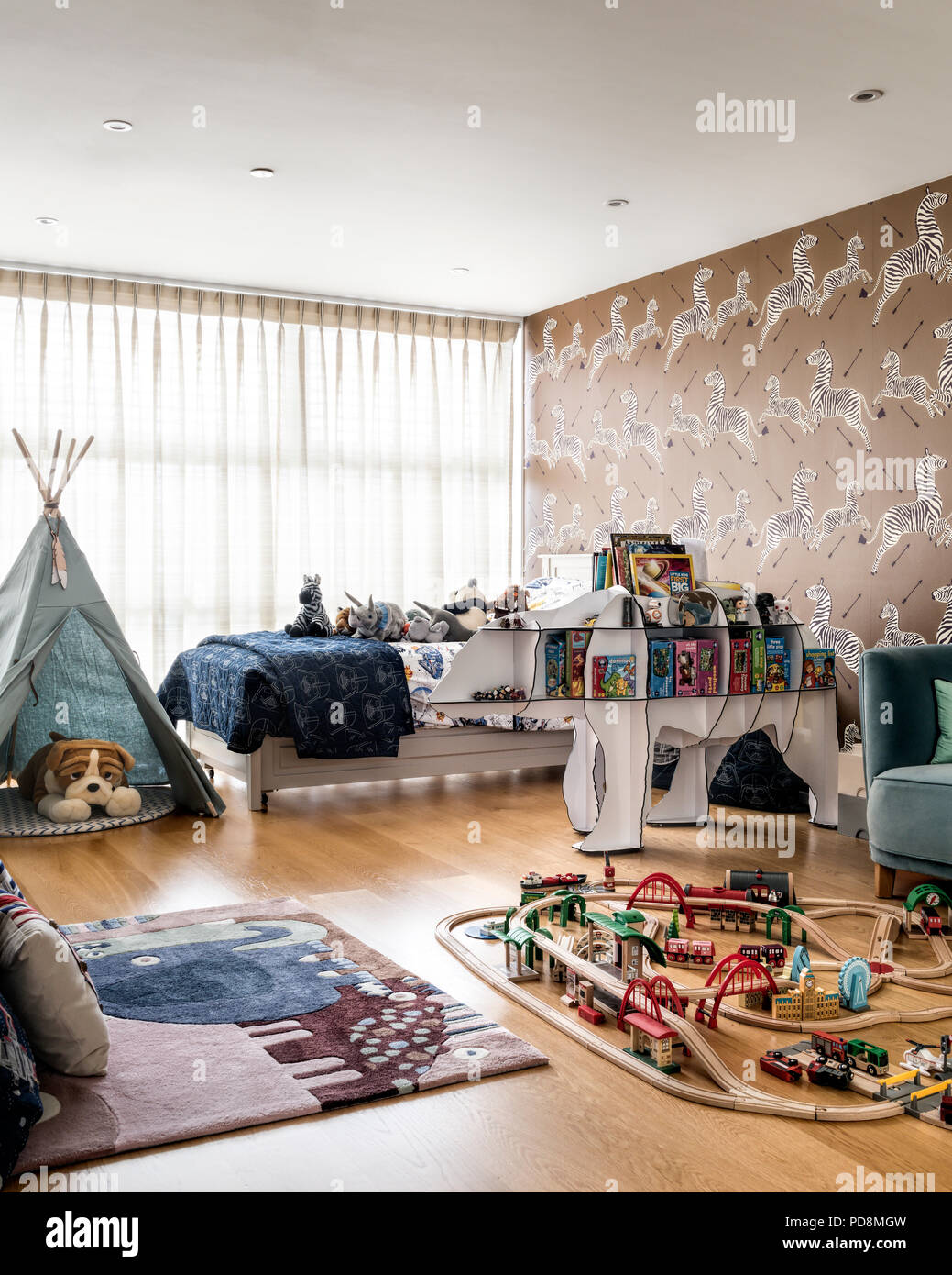 Boys room with wigwam and trainset Stock Photo