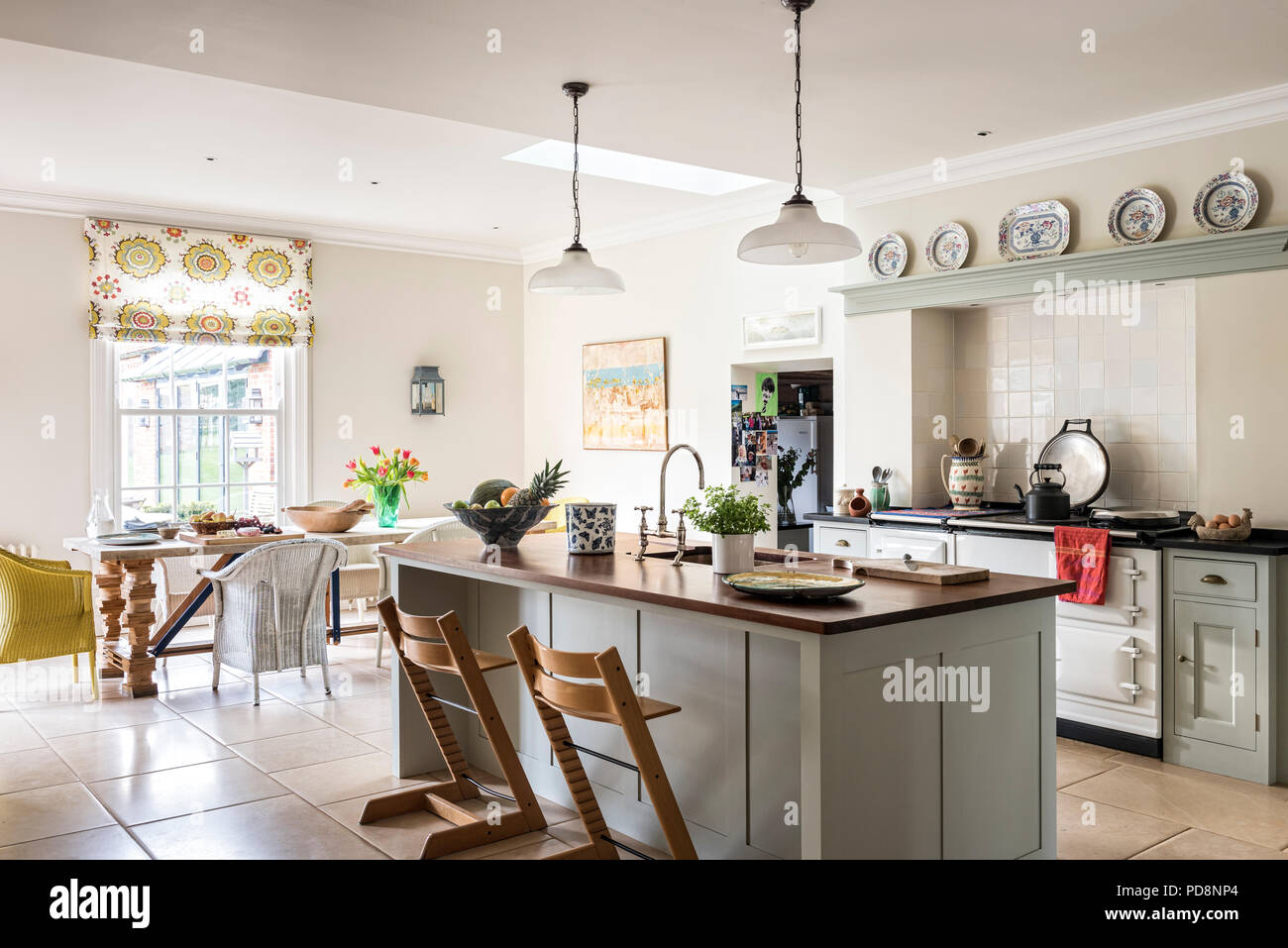 Wooden bar stools at island unit in open plan kitchen diner & Wooden bar stools at island unit in open plan kitchen diner Stock ...