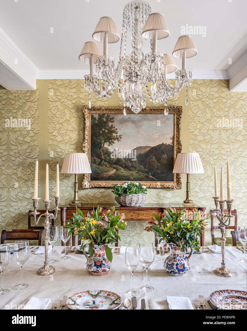 Large Framed Artwork In Dining Room With Glass Chandelier