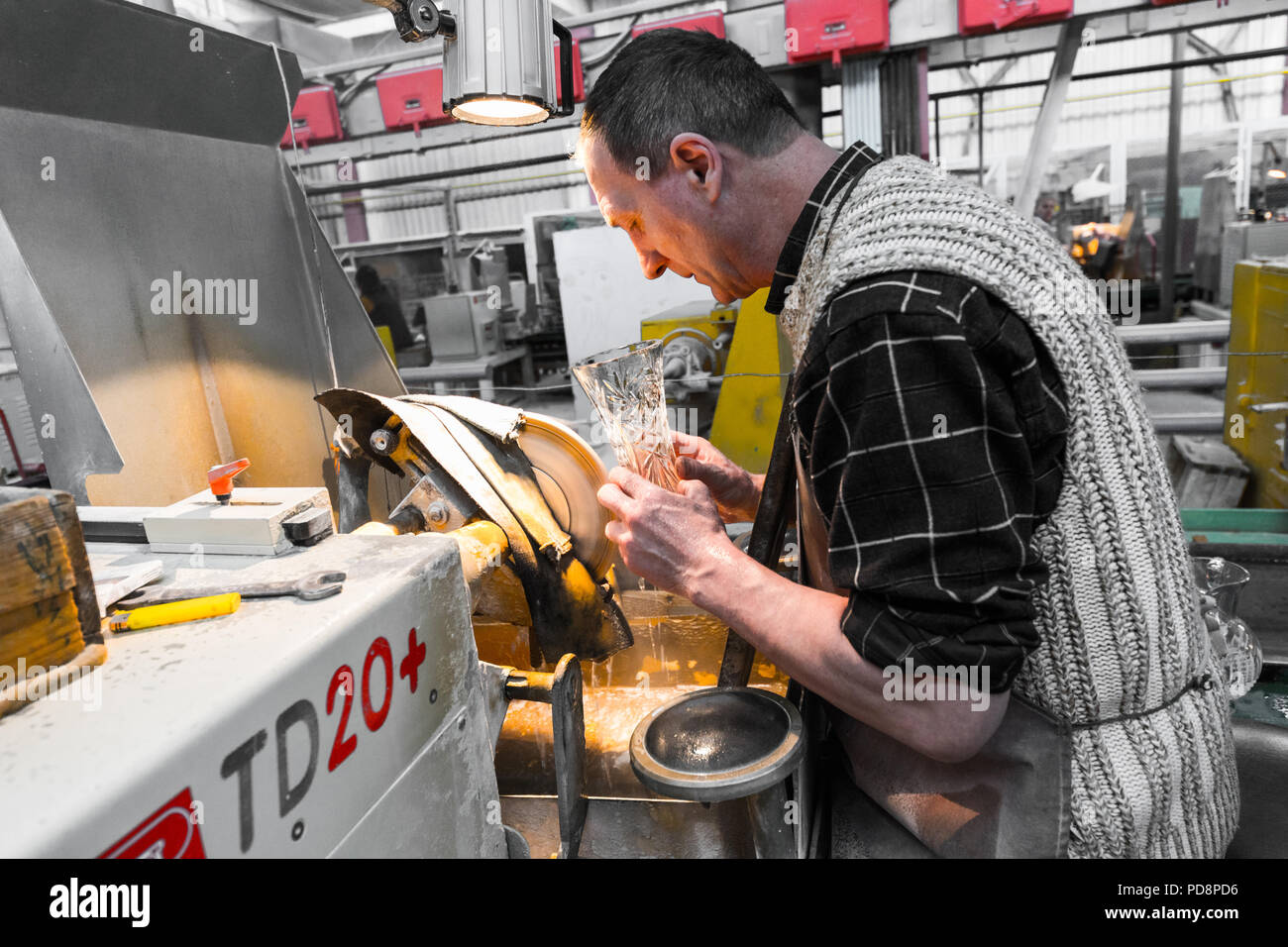 Minsk, Belarus - February 01, 2018: Glass production worker working with industry equipment on factory background Glass production worker working with industry equipment on factory background - Stock Image