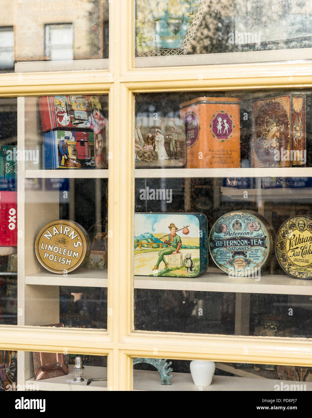 Antique British tins in window display of Michael & Jo Saffell antiques shop, Bath - Stock Image