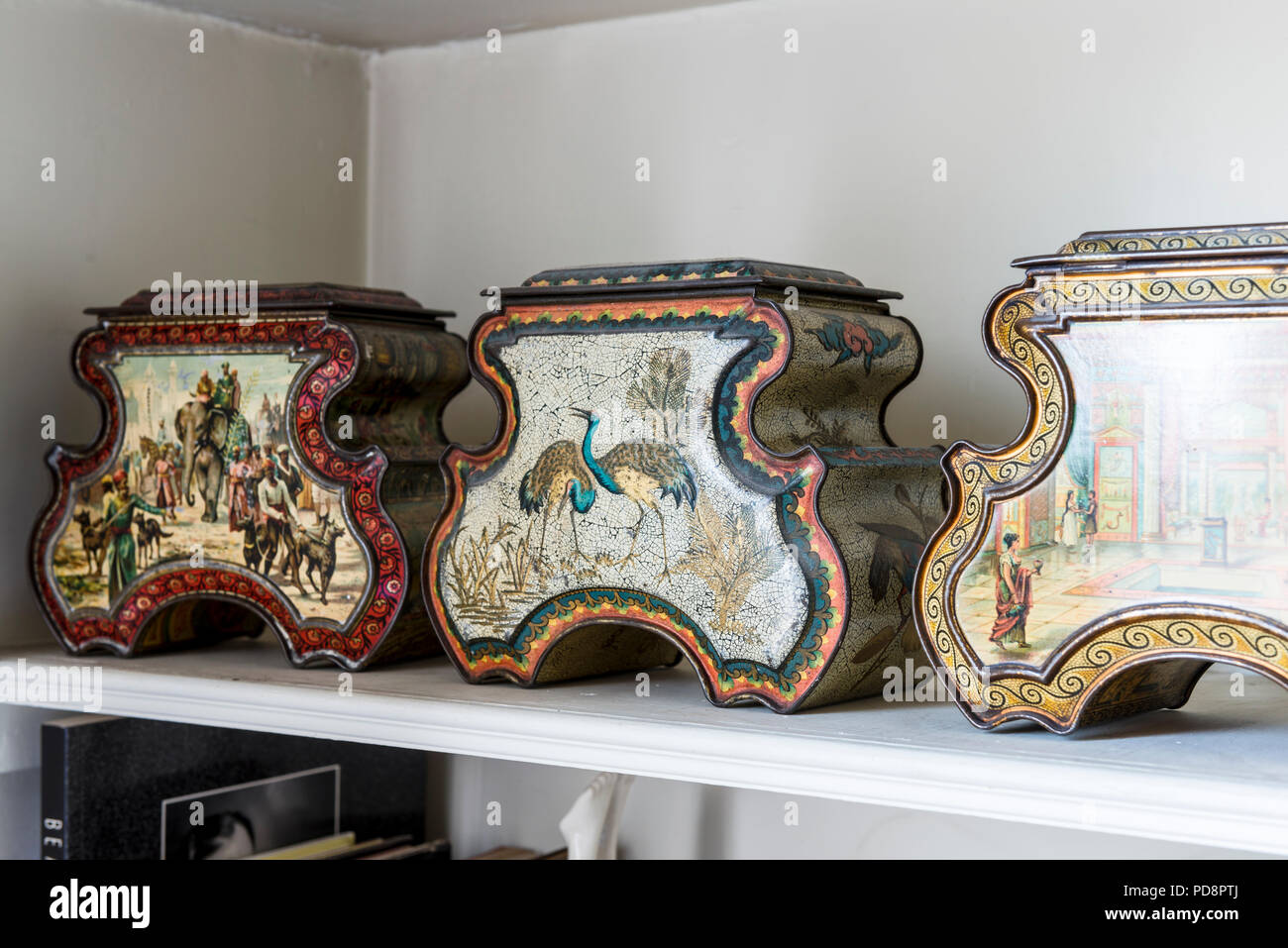 Three Huntley & Palmer oriental-style antique biscuit tins - Stock Image