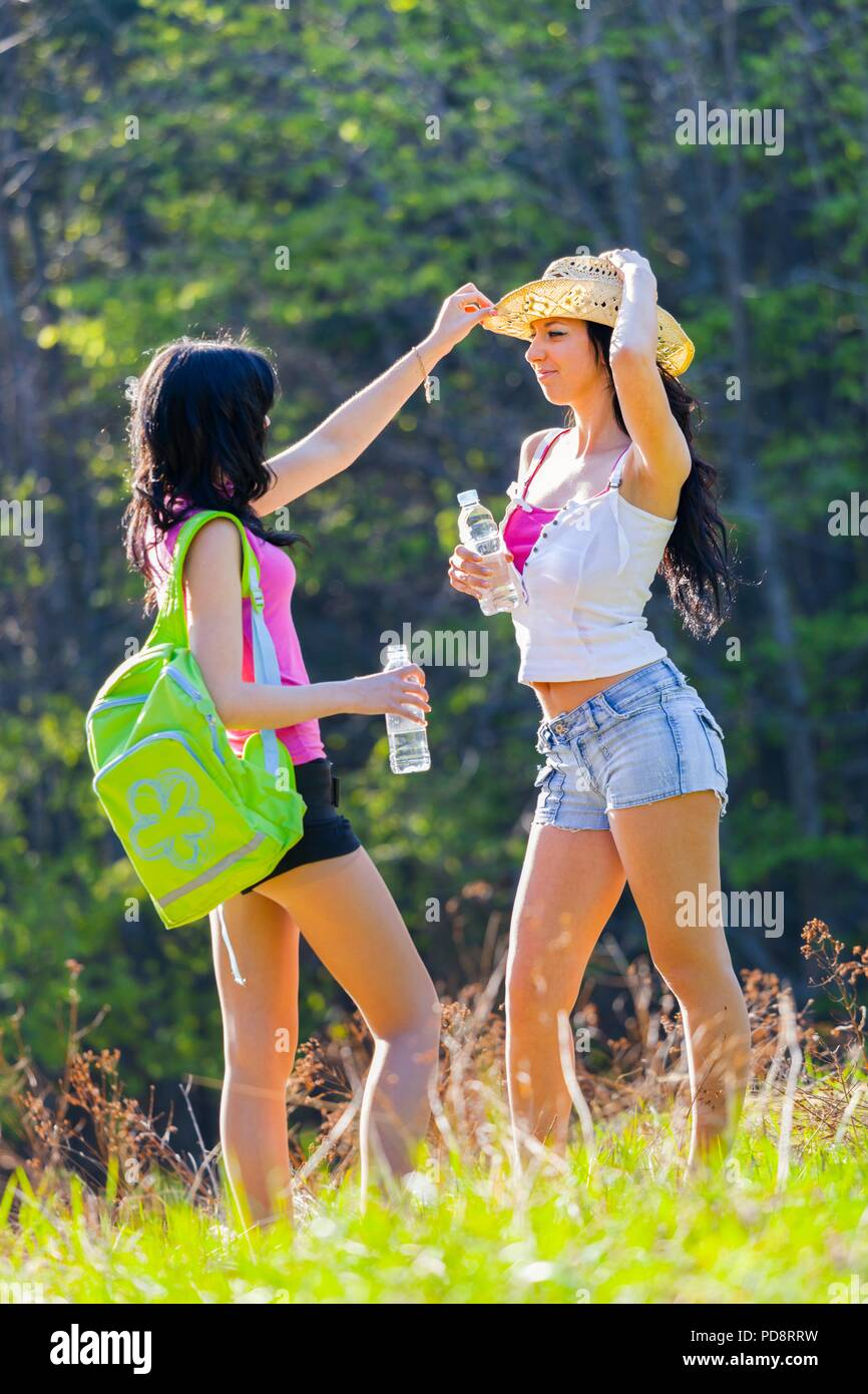 Two good pretty girlfriends in woodland - Stock Image