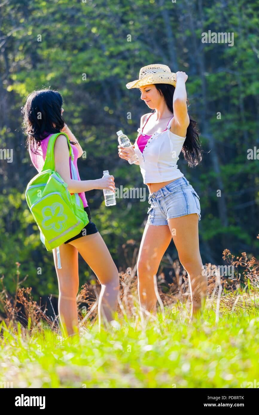 Two good pretty girlfriends in woodland Stock Photo