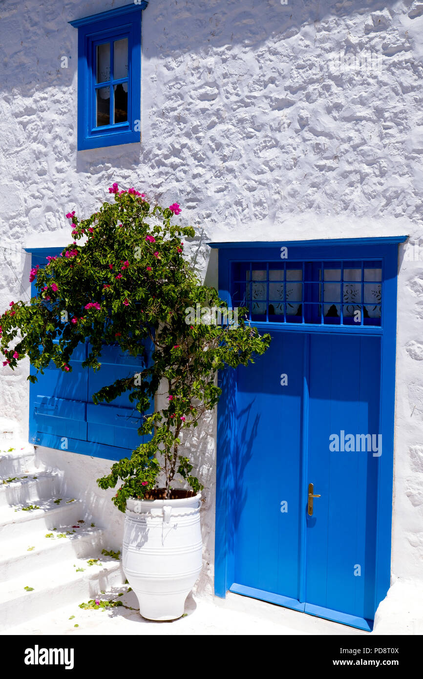 A house brightly painted in tradition greek colours in Hydra Port, the main town of Hydra.  Hydra is one of the islands in the Aegean's Saronic Gulf. - Stock Image