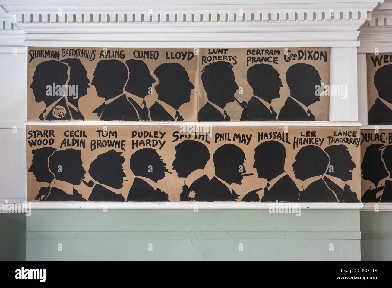 The silhouettes of past Sketch Club members adorn the wall of the clubroom - Stock Image